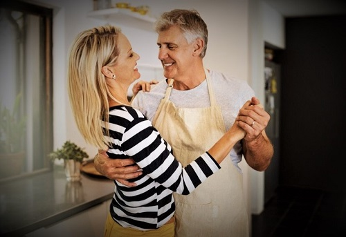 Shot of a happy mature couple keeping each other company in the kitchen